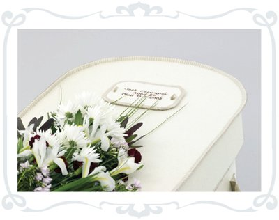 Funeral Services Leeds - Coffin with flowers